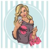 Blonde with a handbag makes a selfie. Stylish blonde with a handbag makes a selfie, duckface, striped minty background Royalty Free Stock Photo