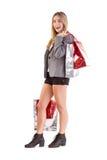 Stylish blonde holding shopping bags Royalty Free Stock Photo