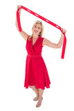 Stylish blonde in red dress holding scarf Stock Photos