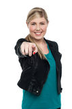Stylish blonde teen girl pointing you out Royalty Free Stock Image