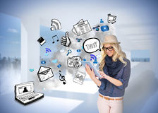 Stylish blonde using tablet pc with app icon doodles Royalty Free Stock Image