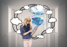 Stylish blonde using tablet pc with app icons and cloud Royalty Free Stock Photos