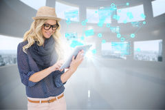 Stylish blonde using tablet pc with email and interfaces Royalty Free Stock Image