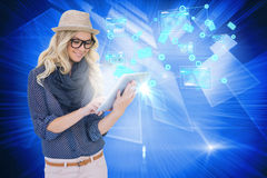 Stylish blonde using tablet pc email and interfaces Stock Photos