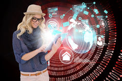 Stylish blonde using tablet pc with interfaces and email icons. Digital composite of stylish blonde using tablet pc with interfaces and email icons Royalty Free Stock Images