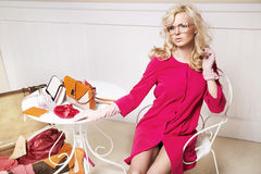 Stylish blonde lady in room full off fashion elements Stock Photos