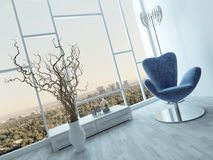 Stylish blue armchair in a modern white room Royalty Free Stock Photography