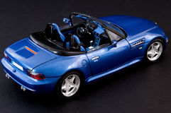 Stylish blue covertible roadster. Picture of a blue beautiful roadster Stock Photo