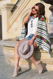 Stylish boho girl in the summer city Royalty Free Stock Images