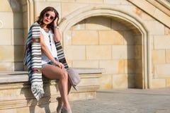 Stylish boho girl in the summer city Stock Images