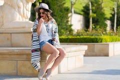 Stylish boho girl in the summer city Stock Image