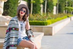 Stylish boho girl in the summer city Royalty Free Stock Image