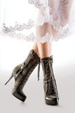 Stylish Boots. Legs of a female model wearing stylish boots Royalty Free Stock Photos
