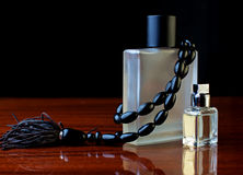 Stylish bottle of male perfume and black jewelery Stock Image