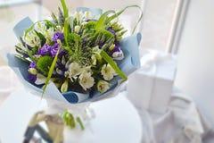 Stylish bouquet of blue flowers. royalty free stock photo