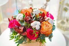 Stylish bouquet of flowers in a beige hat box royalty free stock images