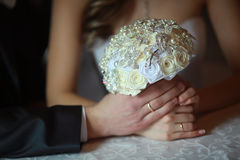 Stylish bouquet in hand, honeymooners Stock Photo