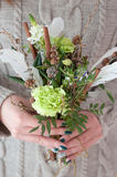Stylish bouquet of pistachio color with cinnamon and feathers Royalty Free Stock Photos