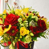 Stylish bouquet with roses and orchids stock photography