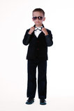 Stylish boy. In a black suit with a butterfly and in glasses full length Stock Image