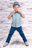 Stylish boy in elegant suit and hat.A little businessman. Children`s fashion. A little businessman.Children`s fashion.Stylish boy royalty free stock photo
