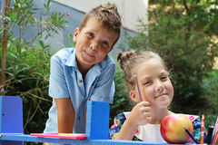 Stylish boy and girl playng school outside. Education and kids fashion concept Stock Photo