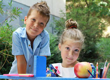 Stylish boy and girl playng school outside. Education and kids fashion concept Stock Photography