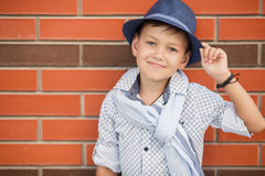 Stylish boy in the street near his home Stock Image