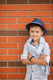 Stylish boy in the street near his home Royalty Free Stock Photo
