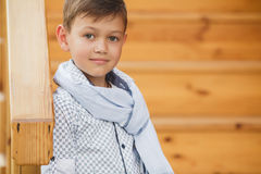Stylish boy in the street near his home Royalty Free Stock Photos