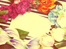 Stylish branding mock up with flowers to display your artworks with vintage filter colors background Stock Photography