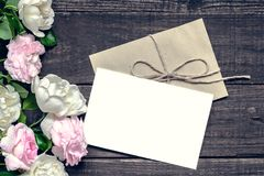 Stylish branding mockup to display your artworks. vintage wedding greeting card with pink and white roses. Mock up on wooden background. mothers background royalty free stock image