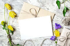 Stylish branding mockup to display your artworks. vintage wedding greeting card. With yellow and purple wildflowers mock up on wooden background. valentines day Stock Images