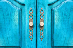 Stylish brass door handles on a cabinet or closet stock photos