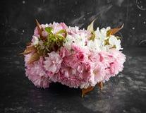 Stylish bridal bouqet of tender white and pink sakura flowers.  stock photo