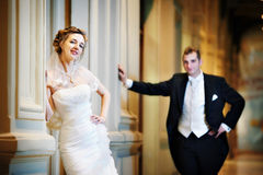 Stylish bride and groom in interior Stock Photography