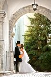 Stylish bride and groom kissing outdoors in the old mansi. On in sunshine at wedding day, vertical shoot Stock Photography