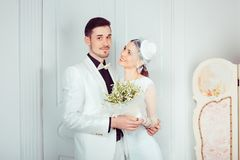 Stylish bride and groom standing in embrace royalty free stock photography