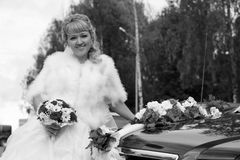 Stylish bride near the old car Royalty Free Stock Image