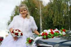 Stylish bride near the old car Royalty Free Stock Photography