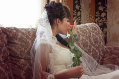 Stylish bride smells rose. Stock Photography