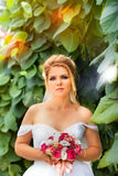 Stylish bride in a white dress on the wedding day Stock Photography