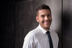 Stylish bristled youthful guy laughing and looking happily Royalty Free Stock Photos