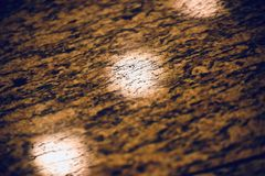 Stylish brown coloured marble tiles surface unique photograph. A beautiful and stylish brown coloured marble tiles object abstract background photograph royalty free stock photos