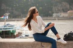 Stylish brunette beauty outdoors. Royalty Free Stock Photo