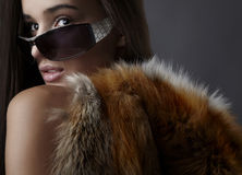 Stylish brunette in the fox cape. Royalty Free Stock Photo