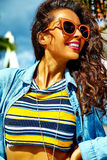 Stylish brunette model in hipster clothes outdoors Stock Photo