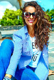 Stylish brunette model in hipster clothes outdoors Royalty Free Stock Images