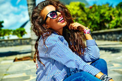 Stylish brunette model in hipster clothes outdoors Stock Images