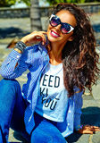 Stylish brunette model in hipster clothes outdoors Royalty Free Stock Photos
